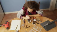 Teenage Girl Working on a Robotics Project video