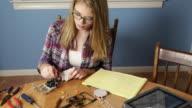 Teenage Girl Working on Robotics Project video