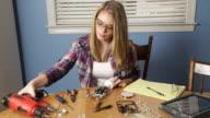 Teenage Girl Works on Robotics Project video