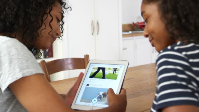 Teenage Girls Looking At Digital Tablet Together video