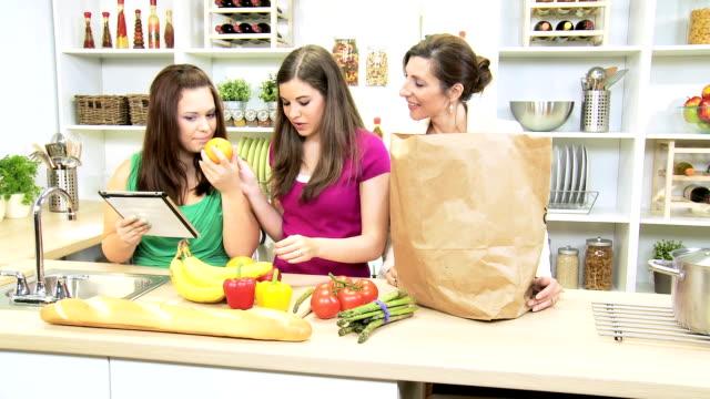 Teenage Girls Mother Kitchen Tablet Fresh Fruit Vegetables video
