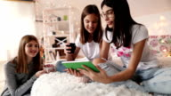 Teenage girls using a digital tablet video