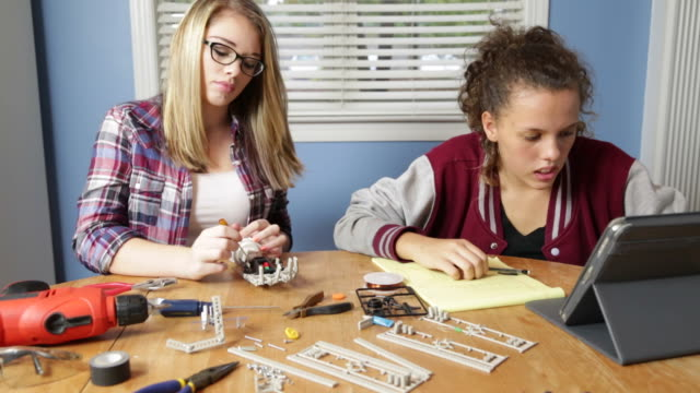 Teenage Girls Work on Robotics Project video