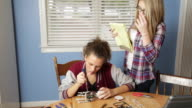 Teenage Girls Work on Robotics Project video