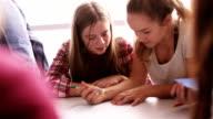 Teenage girls working in school together video