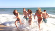 Teenage Group Running Out Of Sea video
