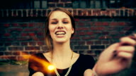 Teenage hipster girl having fun with sparkles video