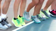 Teenage legs wearing athletic shoes running in place video