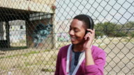 Teenage male listening to music on headphones video