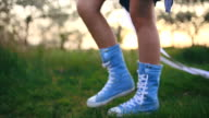 Teenager girl holding long paper and walking in long blue canvas sneakers video