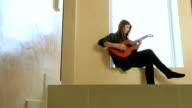Teenager Girl Playing Guitar video