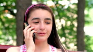 Teenager girl talking on smartphone close up video