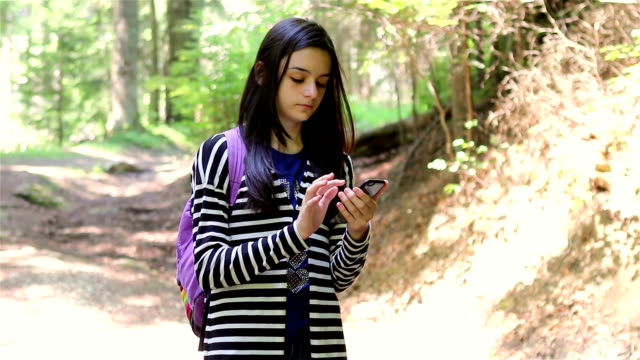 Teenager girl tourist using smartphone video