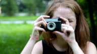Teenager girl with retro camera video