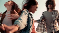 Teenager hipster style friends dancing on the pier at sunset video