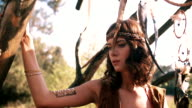 Teenager in boho tribal style fashion in nature video
