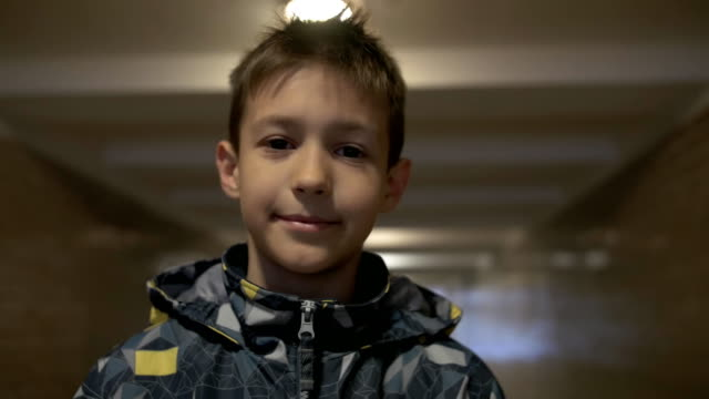 Teenager looking at the camera, standing in the tunnel video