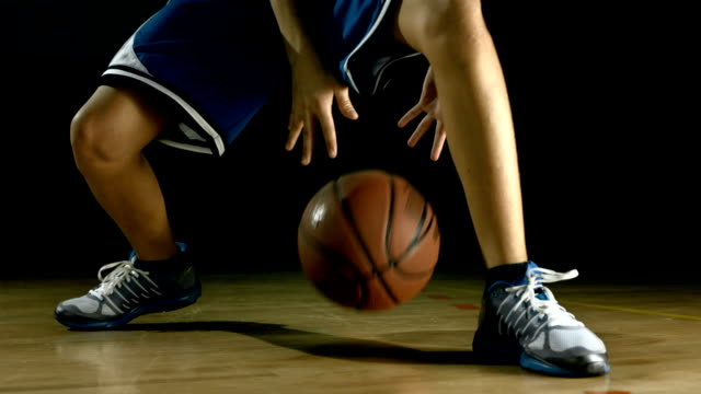 HD: Teenager Practicing Basketball Dribbling video