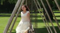 Teenager walking through swings at park video