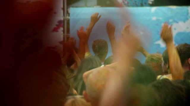 Teenagers dancing to the music at festival, having party, crowd video