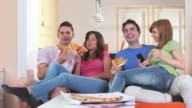 HD DOLLY: Teenagers Eating Pizza And Watching TV video