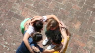 Teenagers embracing together - Cooperation video