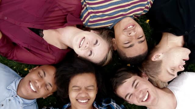 Teens lying on grass video
