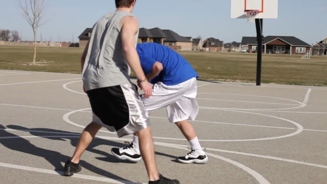 Teens play basket ball video