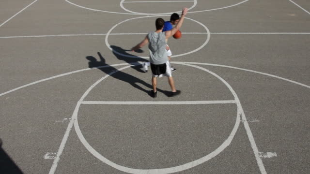 Teens play basketball video