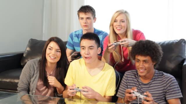 Teens play video games video