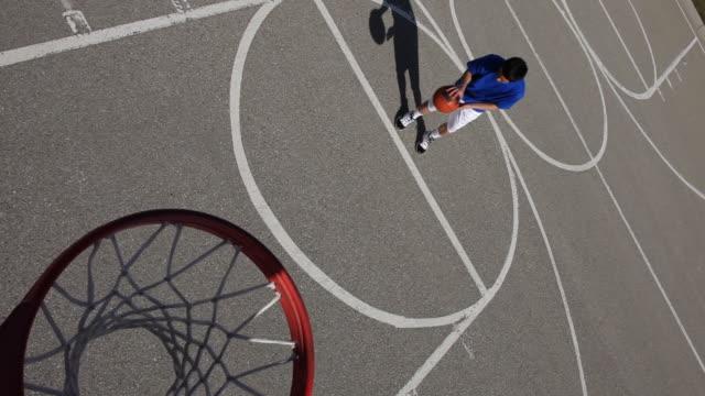 Teens shoots basketball video