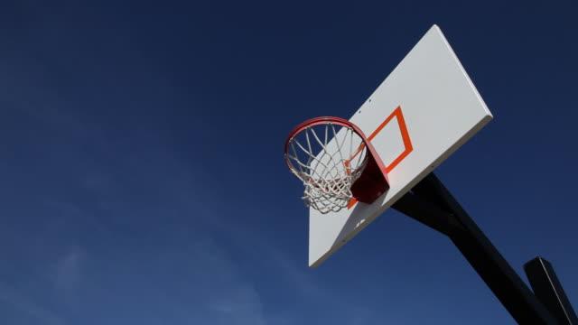Teens slam dunks basketball video
