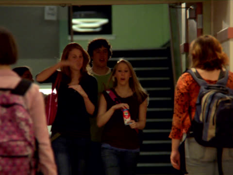 Teens stroll through school halls video