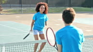 Teens taking tennis clinic, including handicapped girl video