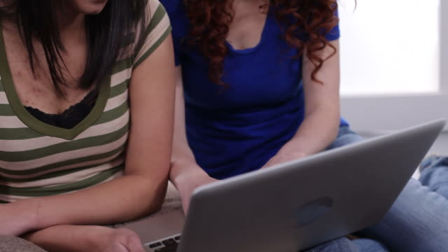 Teens using laptop together video