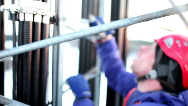 Telecommunication manual high worker engineer repairing antenna video