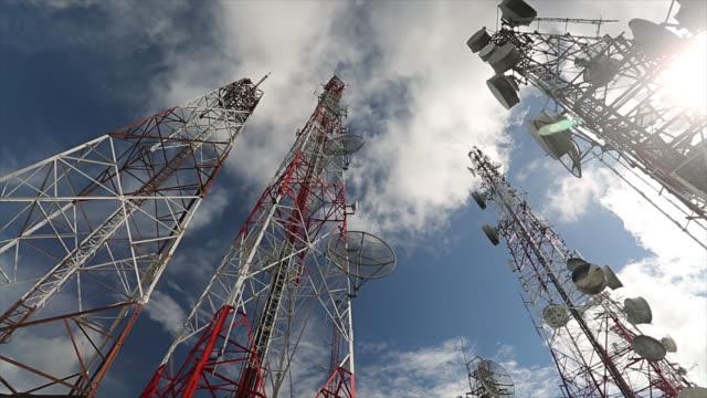 Telecommunication mast TV antennas with blue sky video
