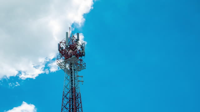 Telecommunication tower against blue sky video