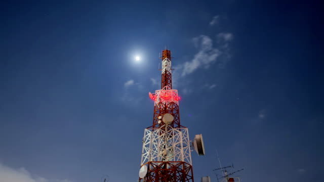 telecommunication Tower Cloudscape at night with star and moon moving video