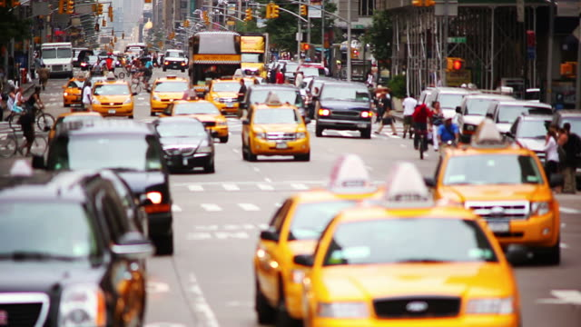 Telephoto city traffic with people video