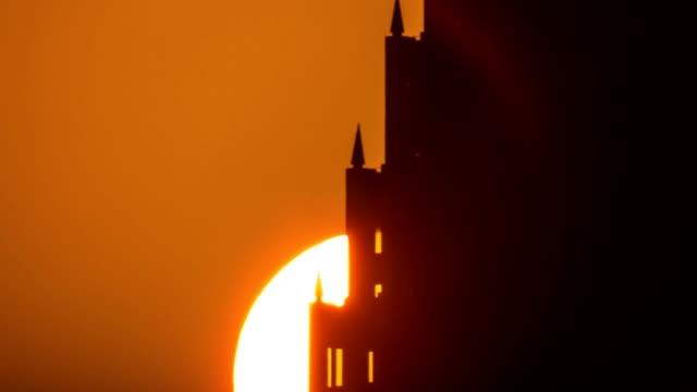 Telephoto of sunrise over Houston building version 2 video