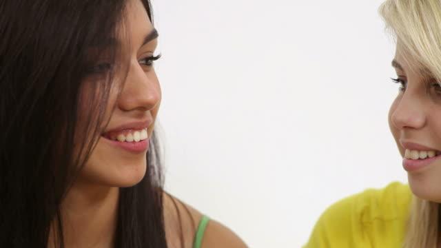 Telling a secret, close up video