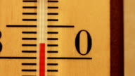 Temperature rising on a thermometer video