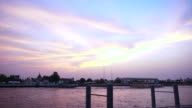 Wat Arun at Sunset, Temple of the Dawn in Bangkok, Thailand, Chao Phraya River. twilight moment of famous skyline video