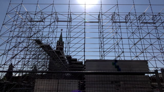 Temporary stage frame, grandstand seating scaffold structure against Kremlin video
