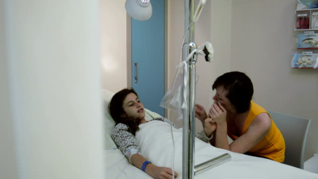 Tenage girl is visited by her older sister in hospital video