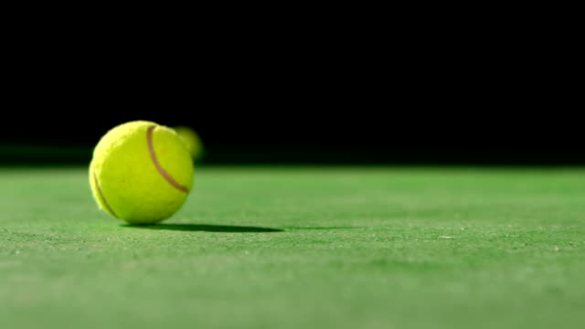Tennis ball rolling on surface video