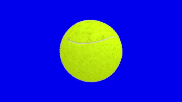Tennis ball turning round on blue screen video
