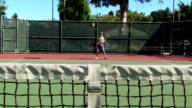 Tennis forehands and backhands behing net - HD video