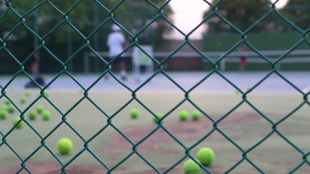 Tennis instructor in action on tennis court video